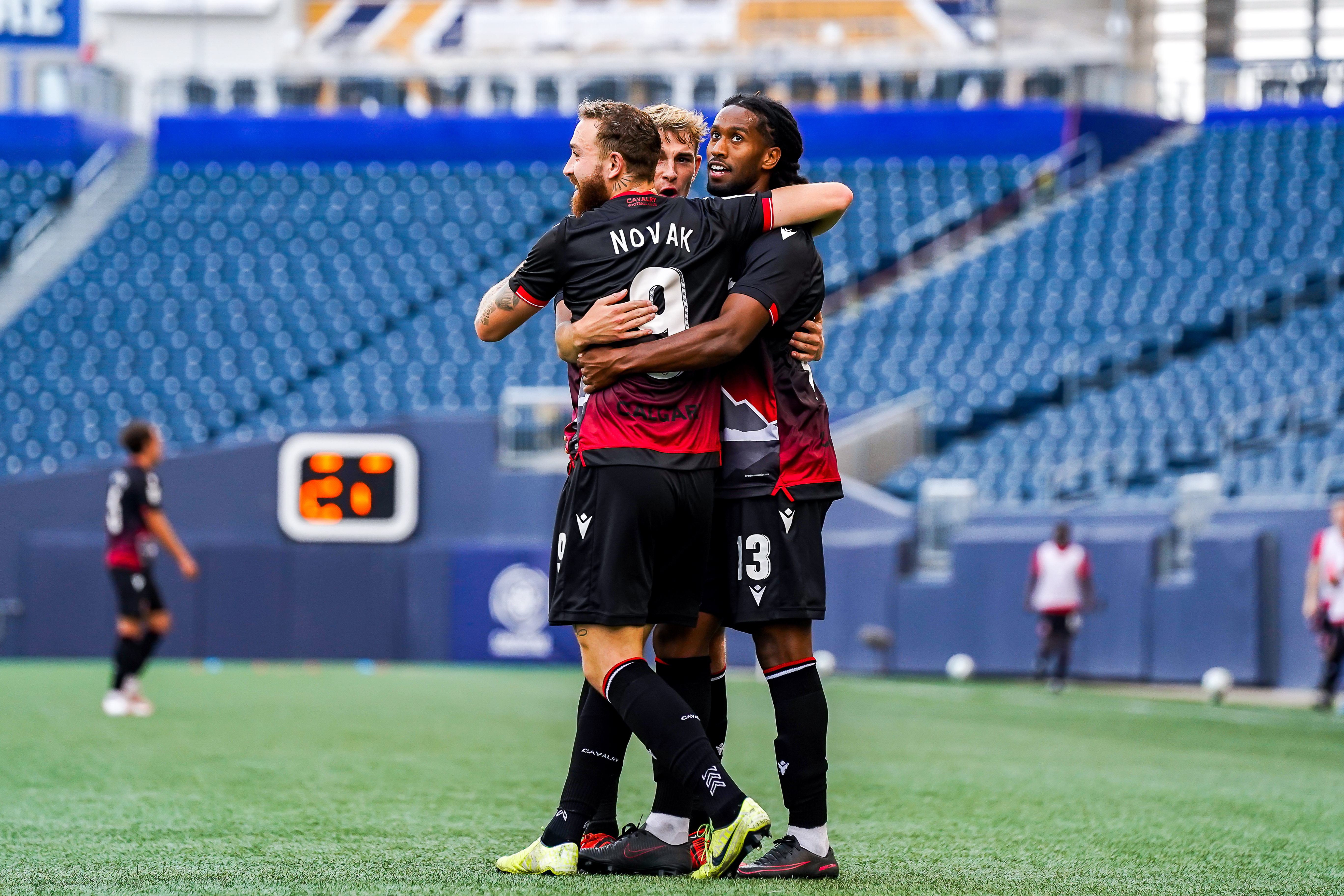 July 17, 2021. HFX Wanderers FC vs Cavalry FC. Second-Half. Ali Musse of Cavalry FC celebrates his goal with teammates Elliot Simmons and Anthony Novak.
