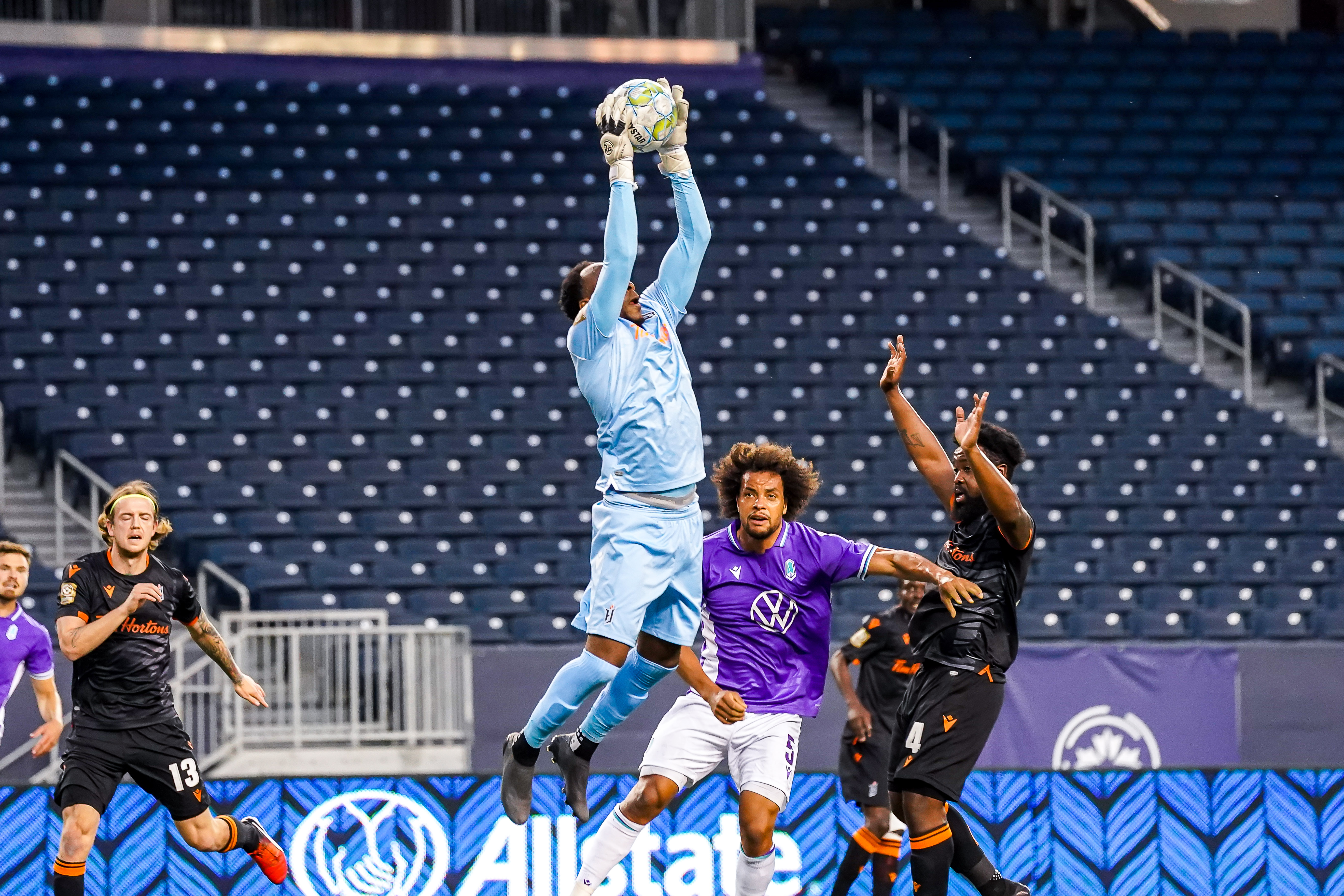 July 17, 2021. Pacific FC vs Forge FC. First-Half. Goalkeeper Triston Henry of Forge FC gets airborne to makes a save.
