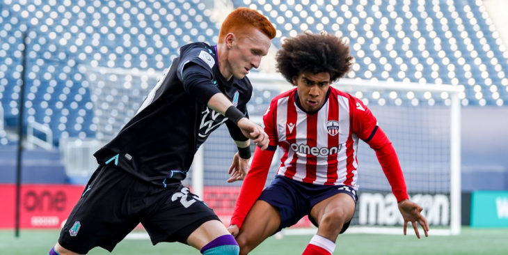 July 7, 2021. Atlético Ottawa vs Pacific FC. First-Half. Oliver Bassett of Pacific FC plays the ball away from Keesean Ferdinand of Atlético Ottawa. (CPL)
