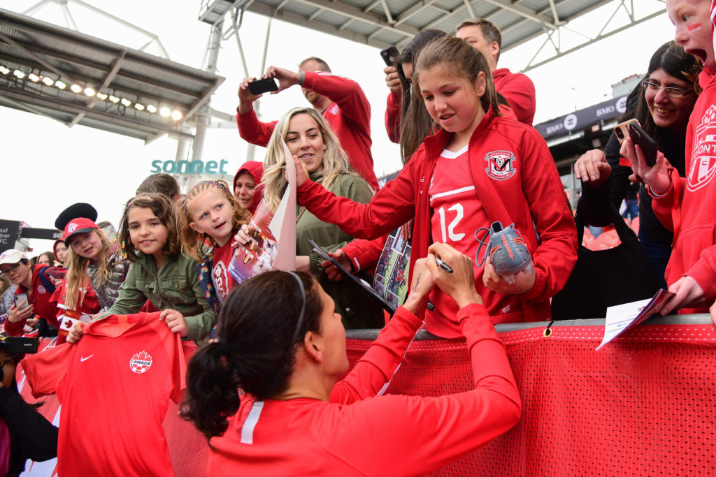 Christine Sinclair signing autographs for fans (Photo: Canada Soccer by Martin Bazyl)