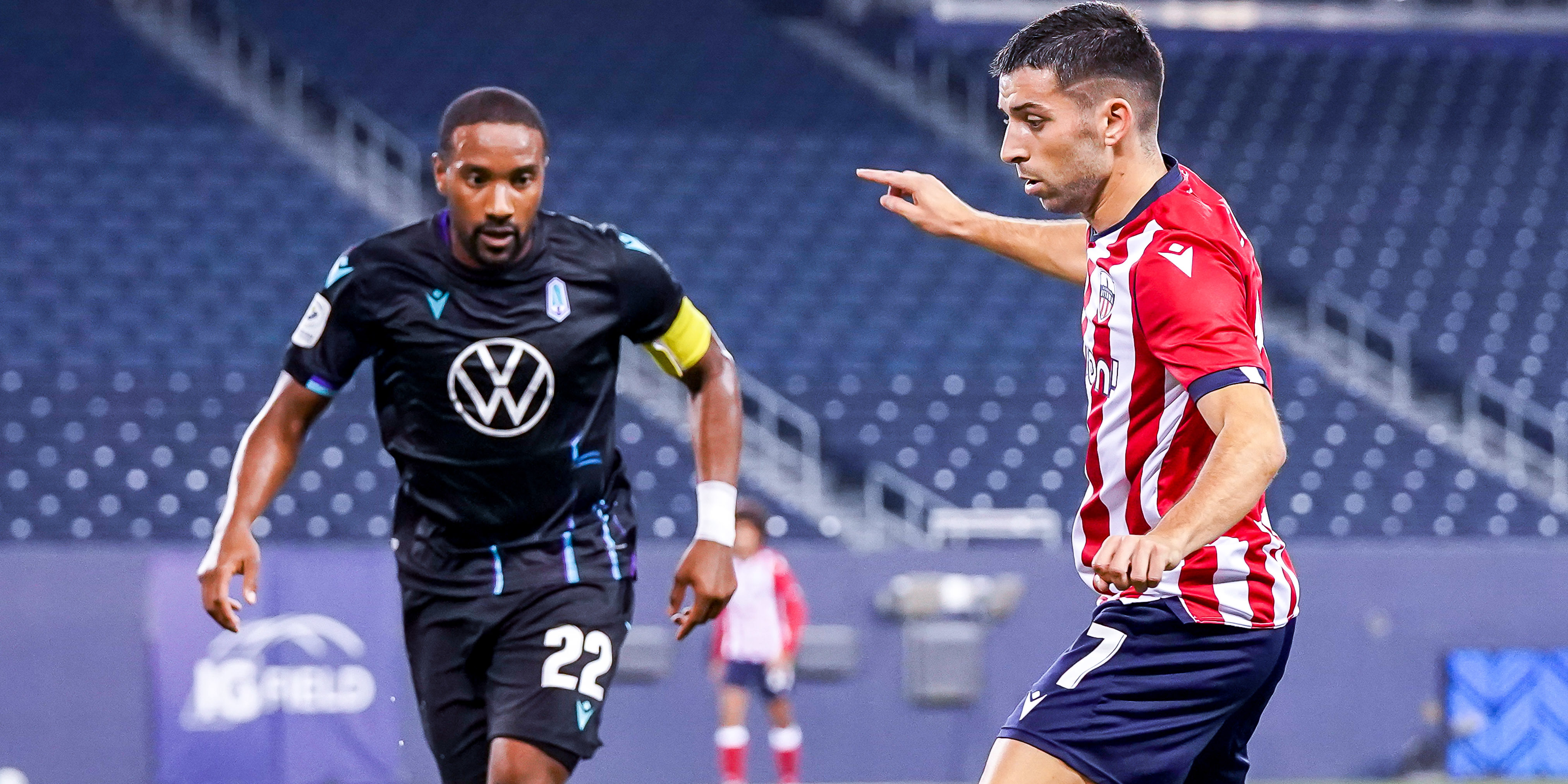 July 21, 2021. Pacific FC vs Atlético Ottawa. First-Half. Miguel Acosta of Atlético Ottawa plays the ball as Jamar Dixon of Pacific FC defends. (CPL)