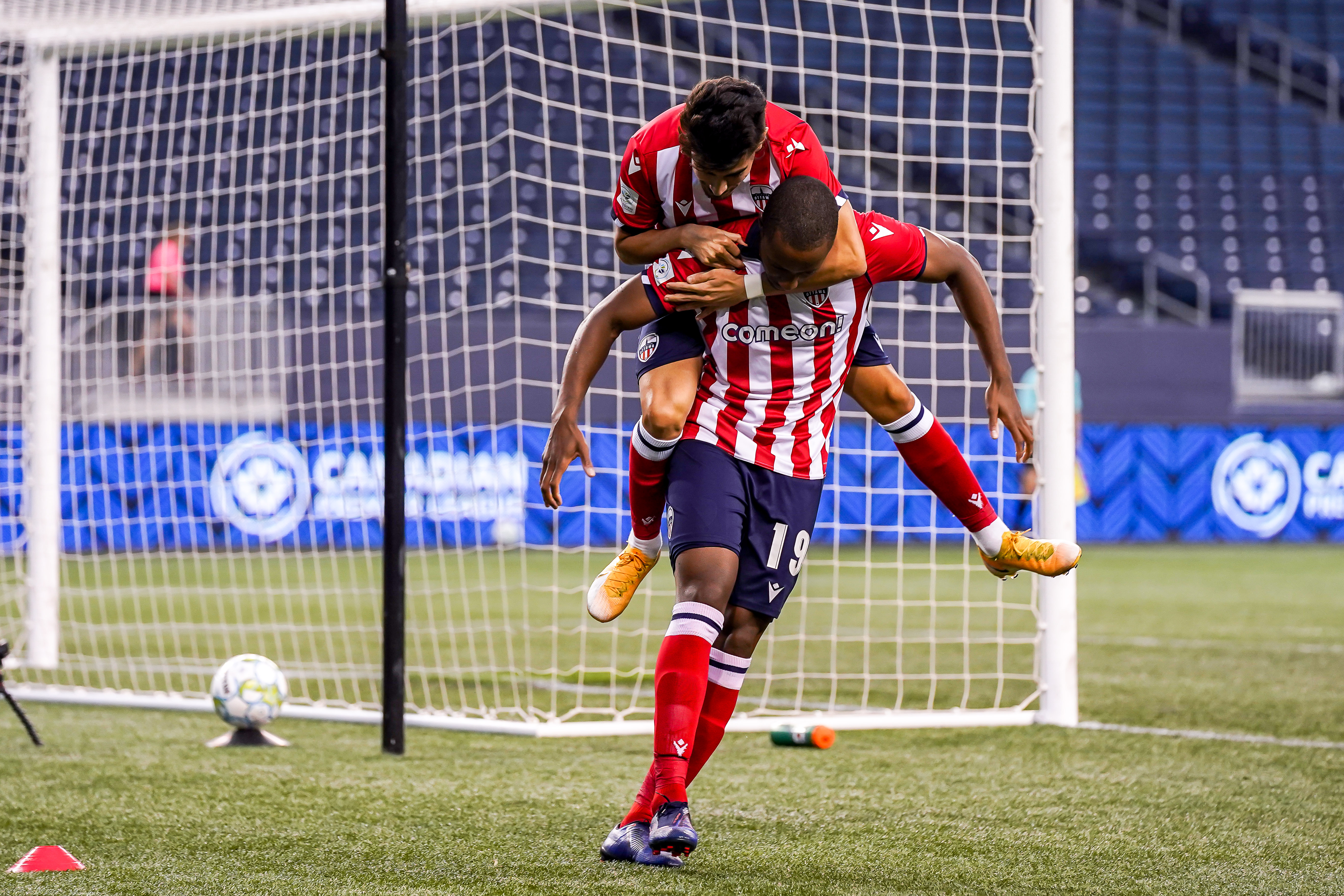 July 21, 2021. Pacific FC vs Atlético Ottawa. First-Half. Alberto Soto of Atlético Ottawa catches a ride on Malcolm Shaw following his first half-goal.
