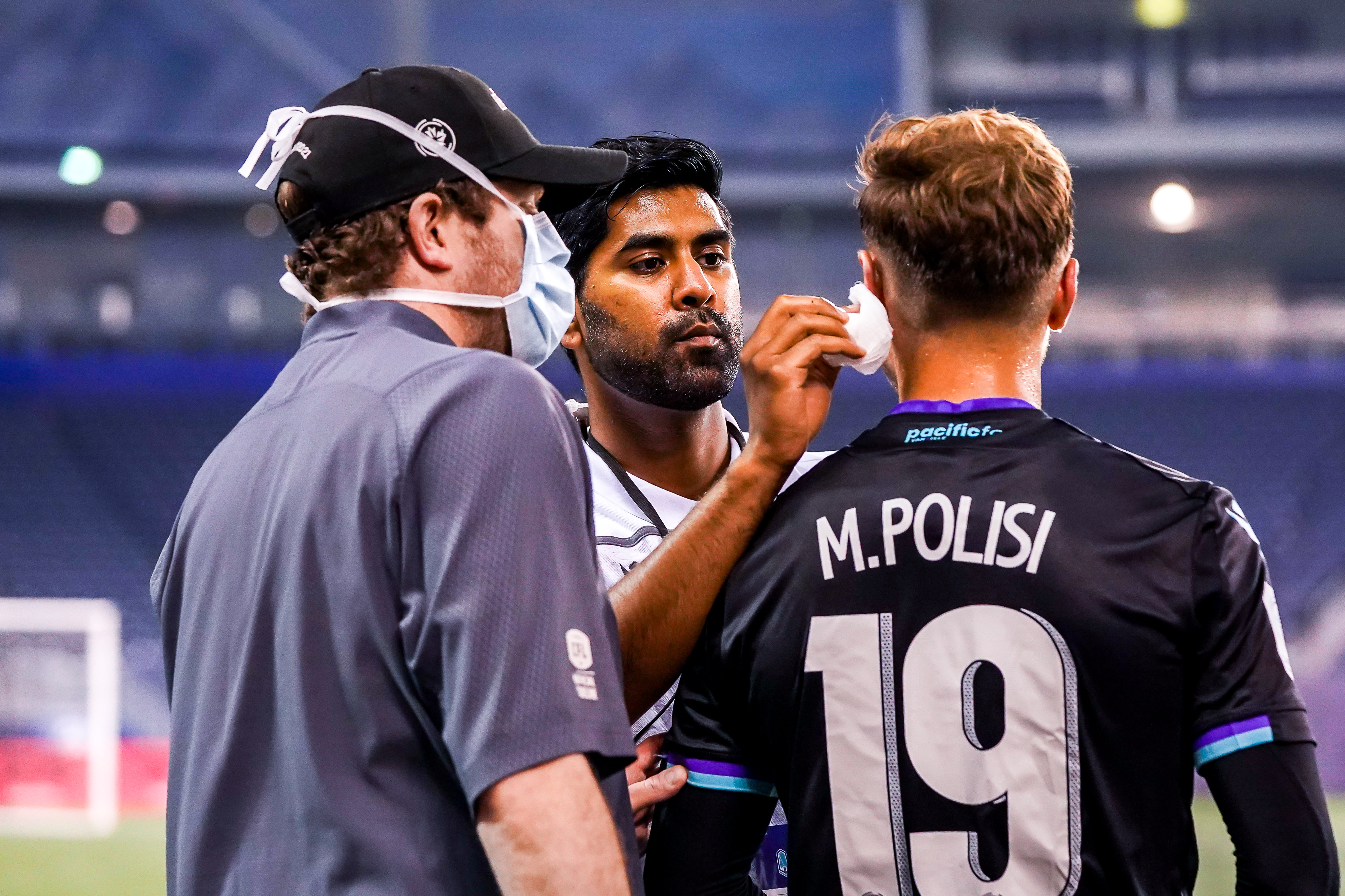 July 21, 2021. Pacific FC vs Atlético Ottawa. First-Half. Matteo Polisi of Pacific FC gets attended to by the Pacific FC physio team.