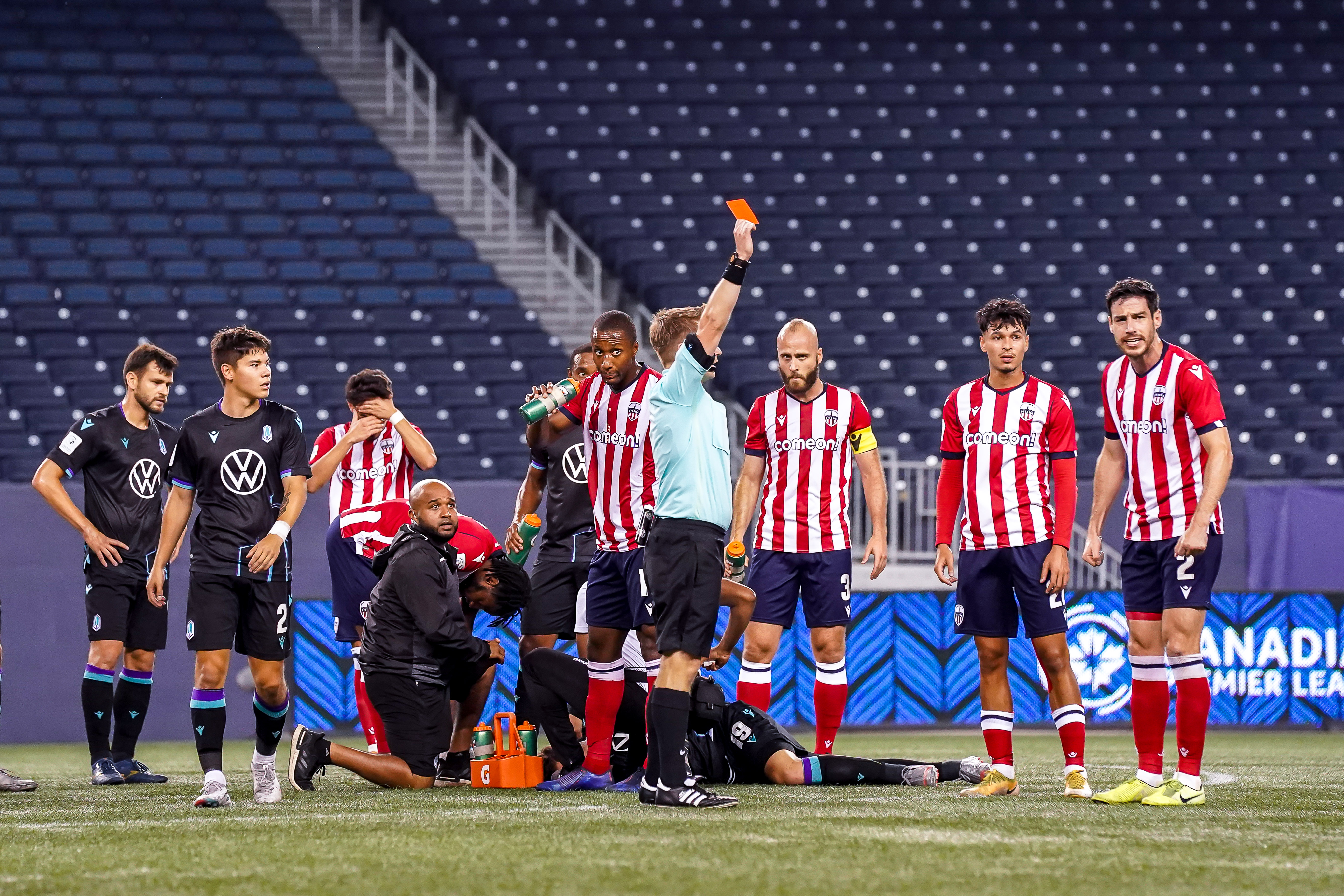 July 21, 2021. Pacific FC vs Atlético Ottawa. First-Half. Referee Ben Hoskins shows a red card to Ben McKendry of Atlético Ottawa (not shown).