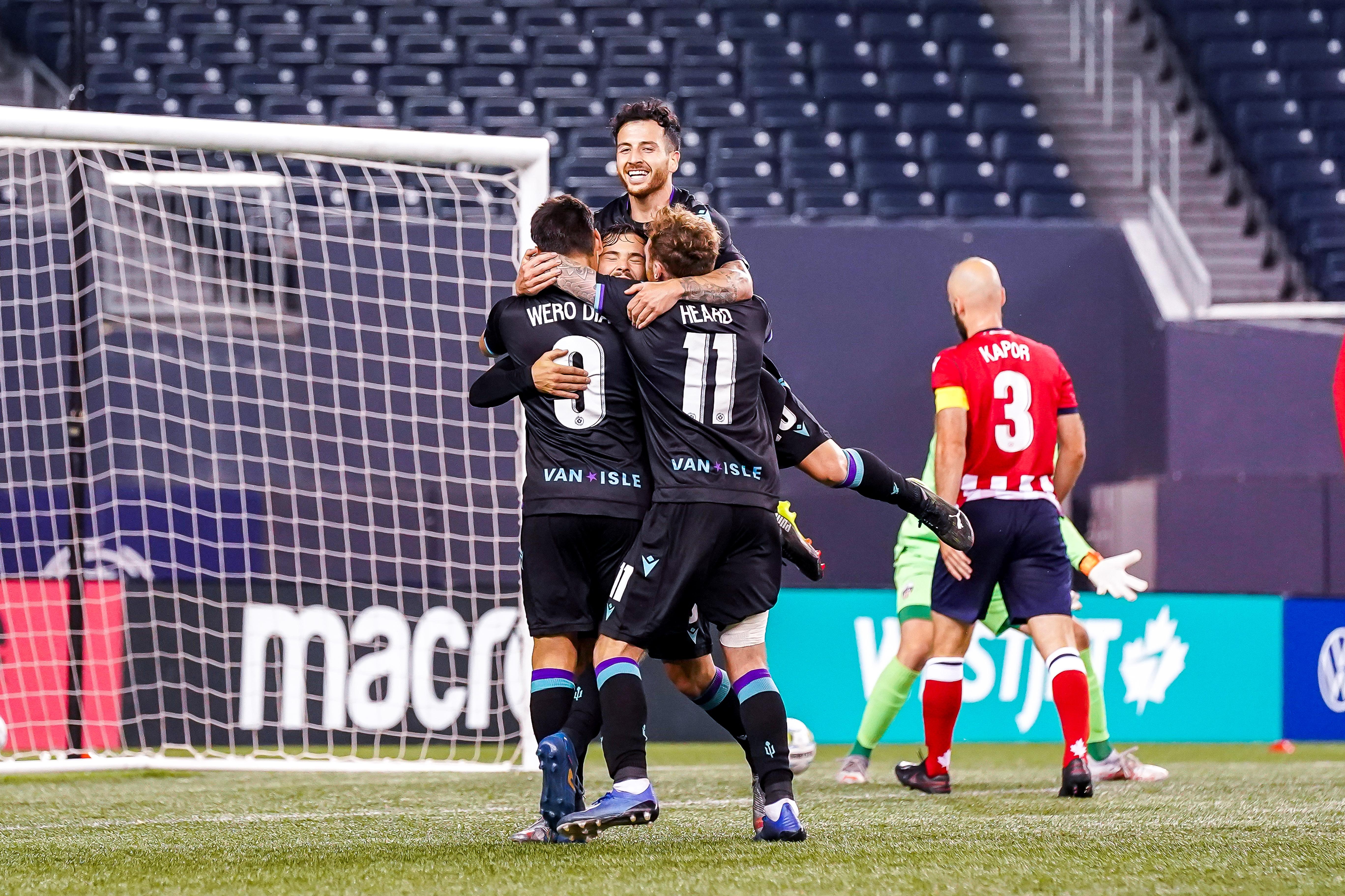July 21, 2021. Pacific FC vs Atlético Ottawa. Second-Half. Pacific FC players embrace Alejandro Díaz following his hat-trick goal against Atlético Ottawa.