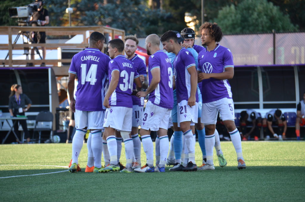 Pacific FC players in a huddle during their match against Valour FC (Photo: Pacific FC/Sheldon Mack/Kelly Wallace)