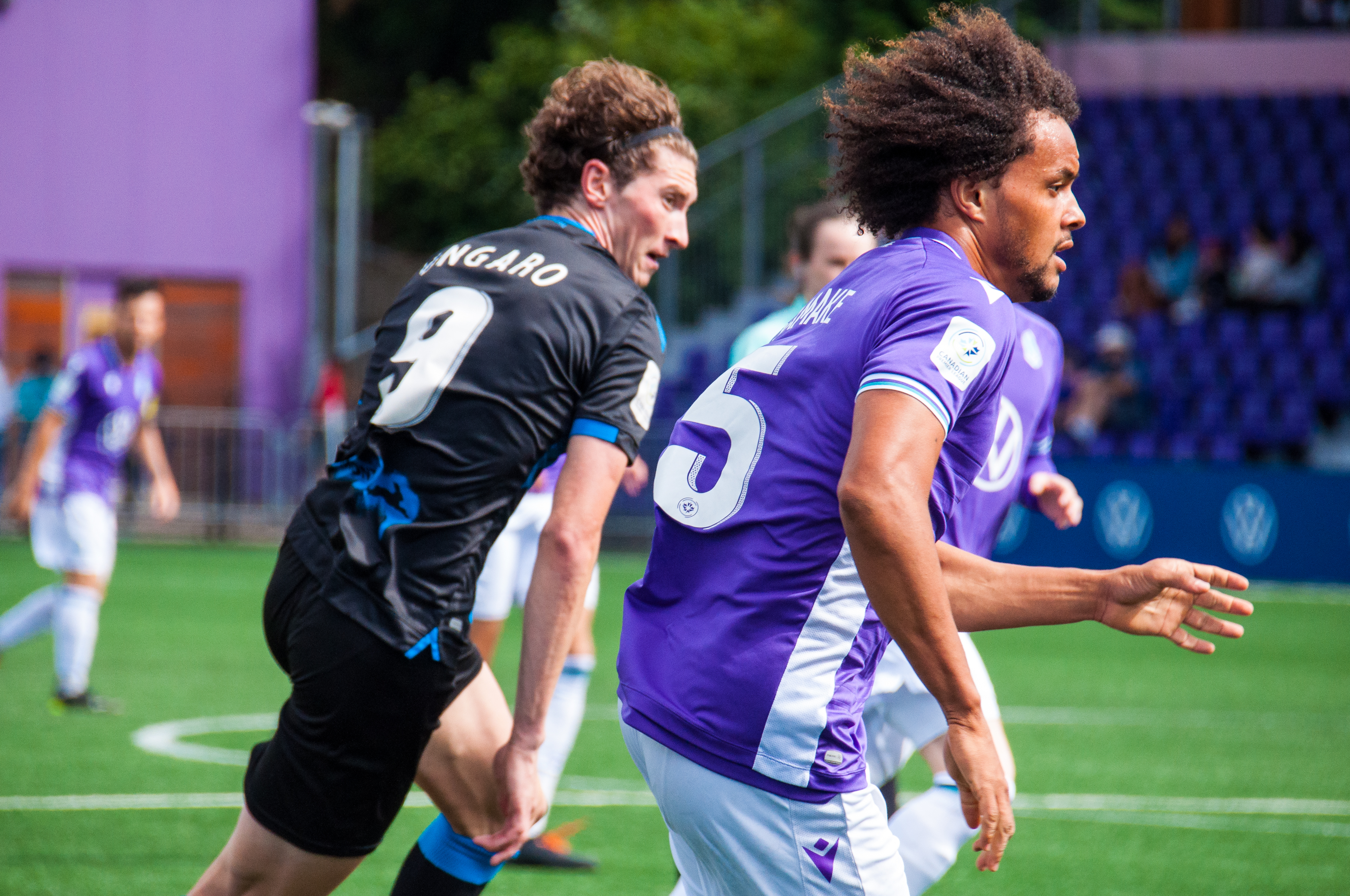 Pacific FC's Abdou Samake chases the ball alongside Easton Ongaro. (CPL)