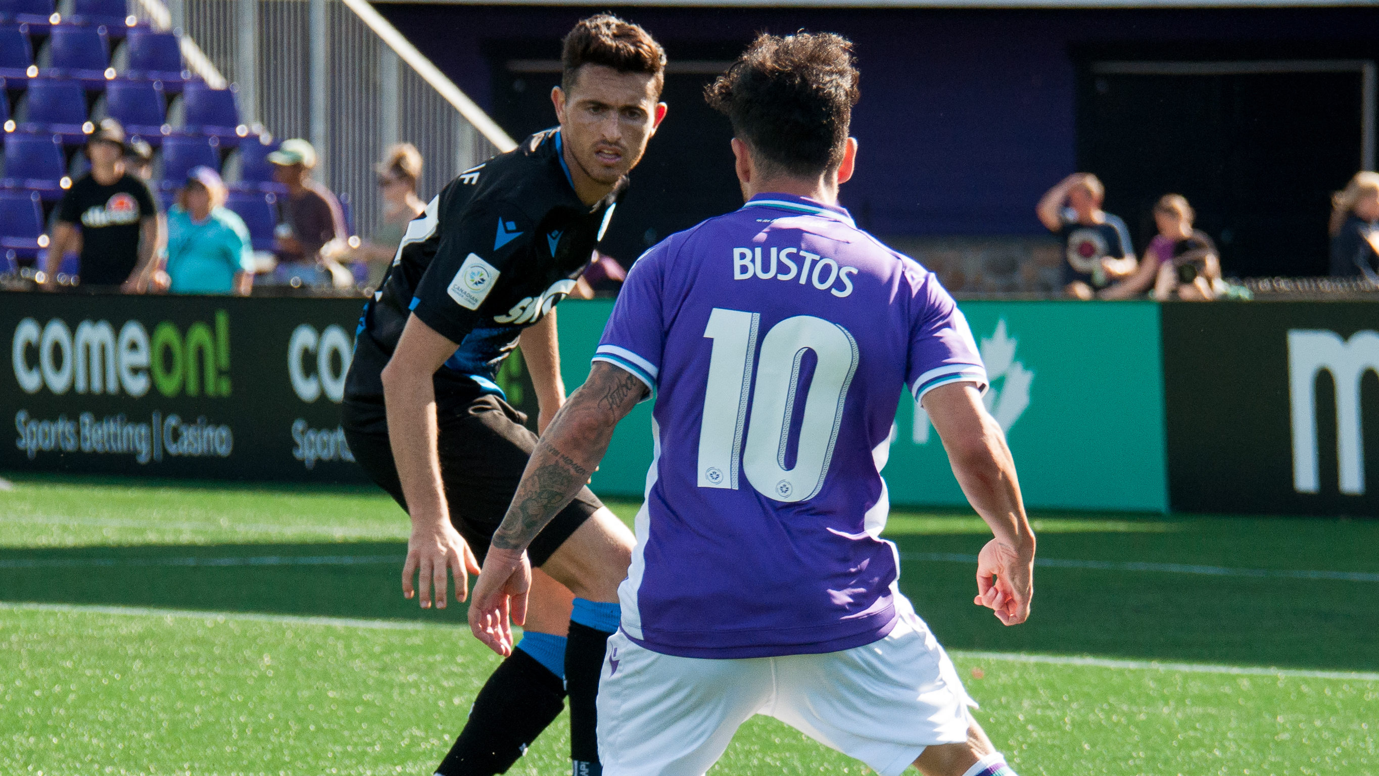 Pacific FCs Marco Bustos and FC Edmonton's Hunter Gorskie. (CPL)