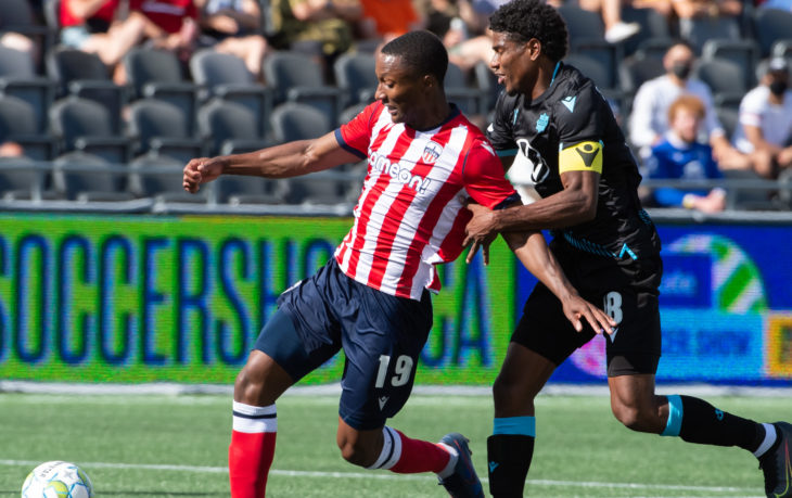 Atlético Ottawa forward Malcolm Shaw plays the ball past Andre Rampersad of HFX Wanderers. PHOTO: Andrea Cardin/Freestyle Photography/CPL