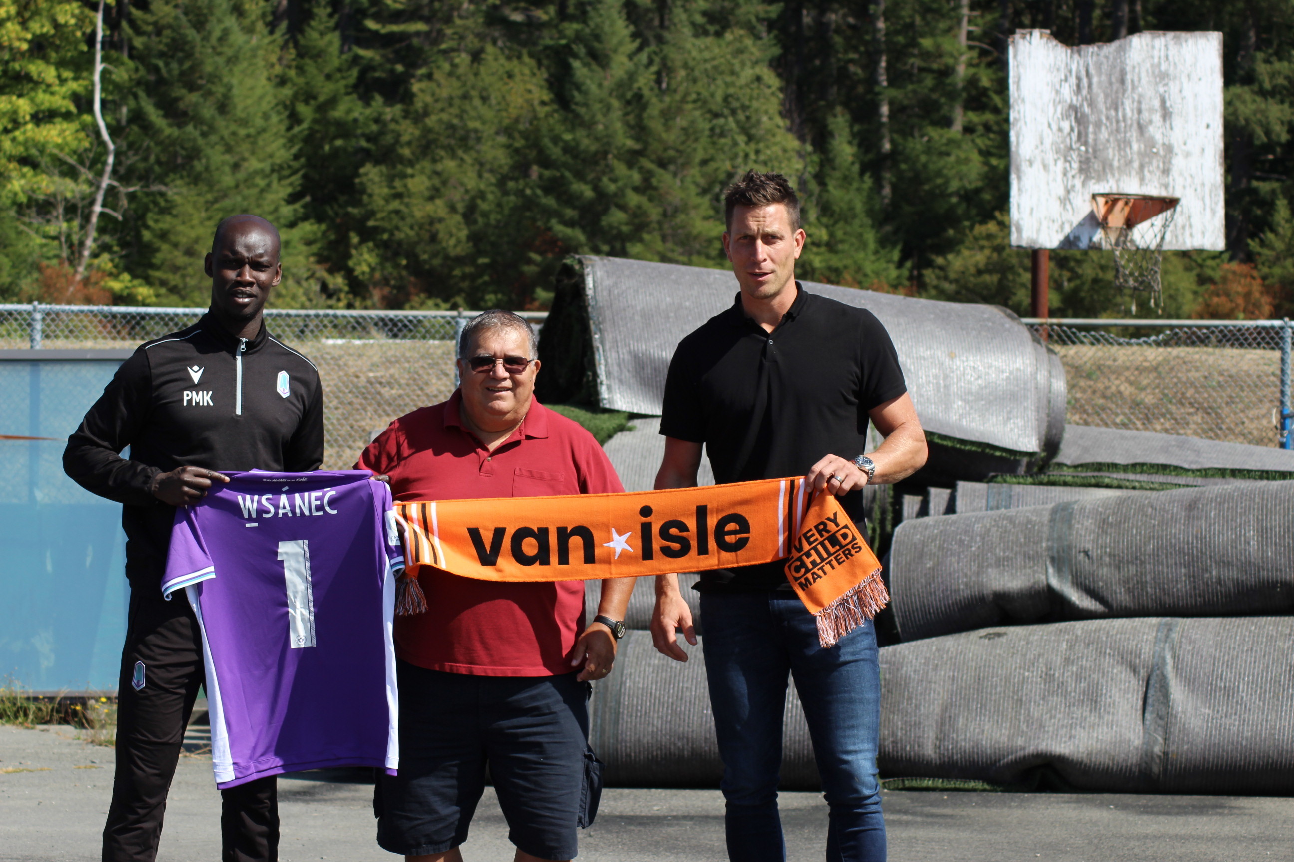 Pa Modou-Kah (head coach Pacific FC), Curtis Olsen (Administrator, WSANEC School Board), and Rob Friend, CEO, Pacific FC.