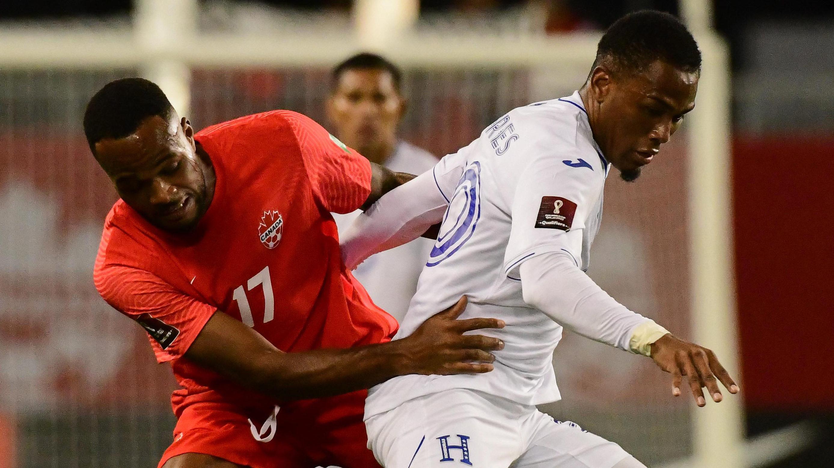 Cyle Larin battles Honduras' Deybi Flores for possession. (Canada Soccer/Martin Bazyl)