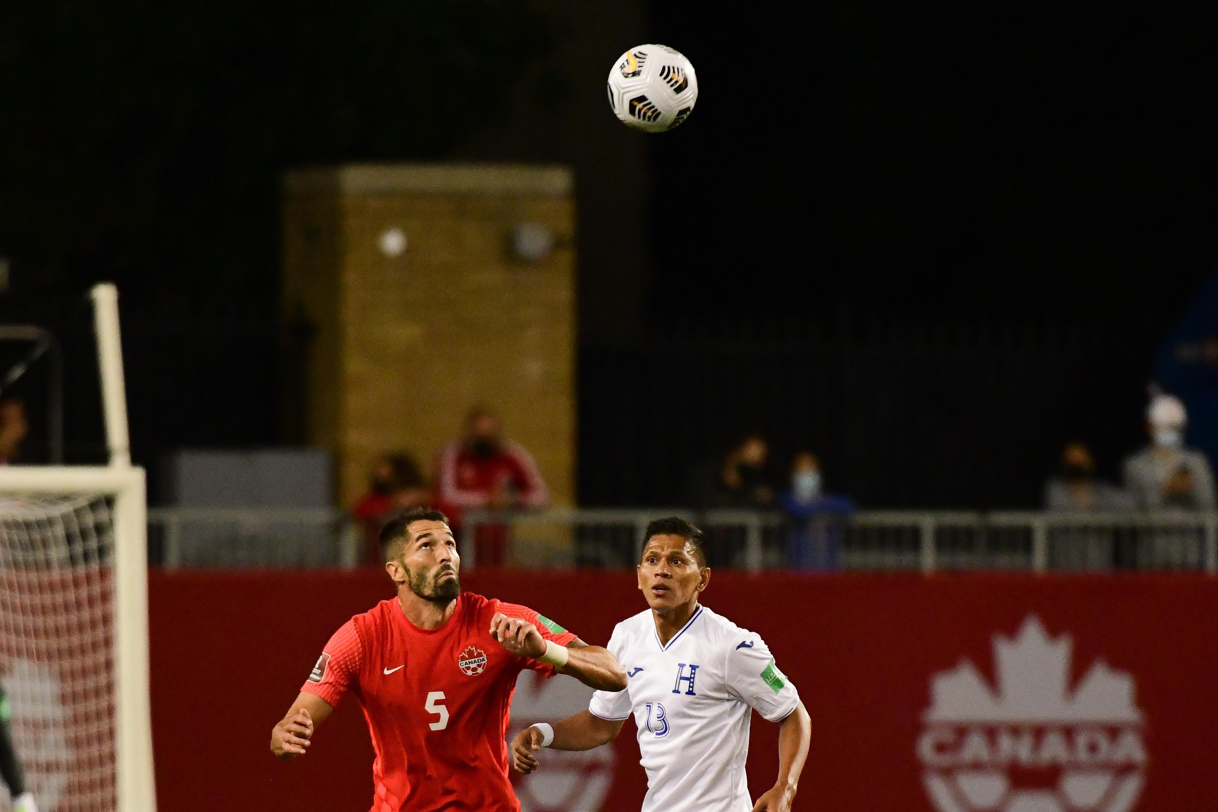Steven Vitória battles Brayan Moya for the ball. (Canada Soccer/Martin Bazyl)