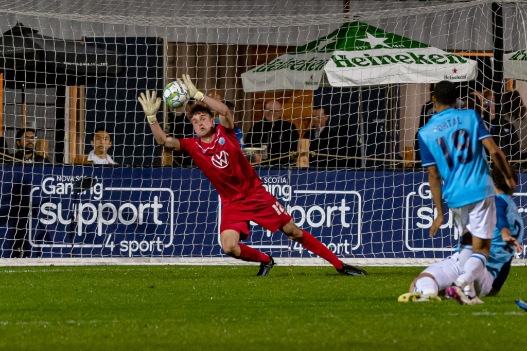 Halifax, Nova Scotia - Oct 06, 2021: HFX Wanderers FC Goalkeeper, Kieran Baskett (12) dives to make a save during the match between HFX Wanderers FC and Forge FC at the Wanderers Grounds in Halifax, Nova Scotia. (Trevor MacMillan/HFX Wanderers FC)