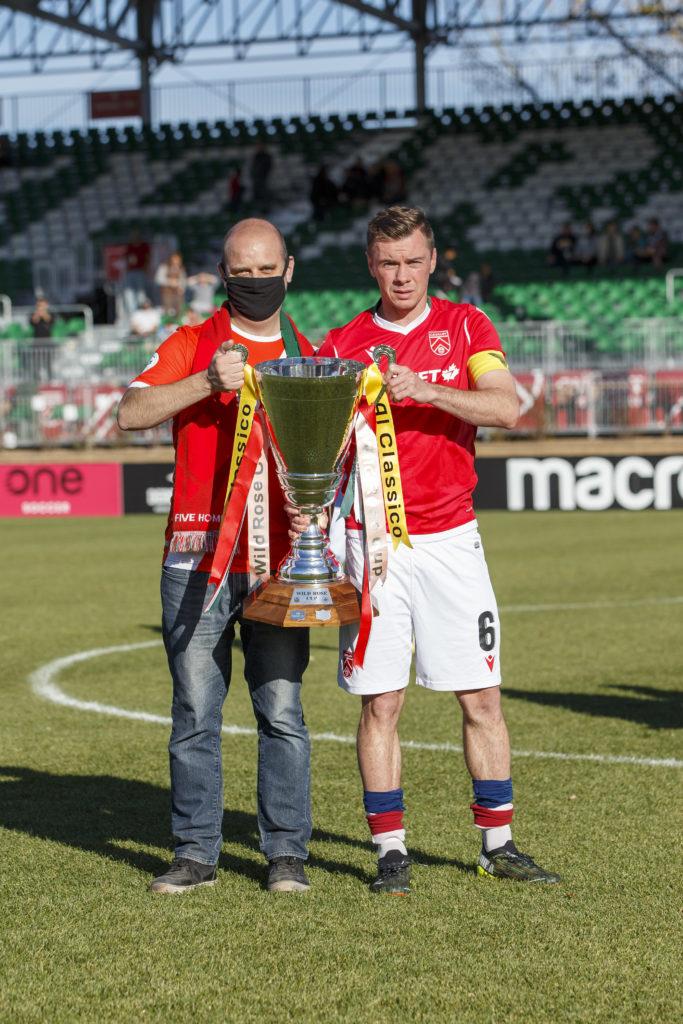 Cavalry FC captain Nik Ledgerwood receives the Wild Rose Cup (CPL/Tony Lewis)