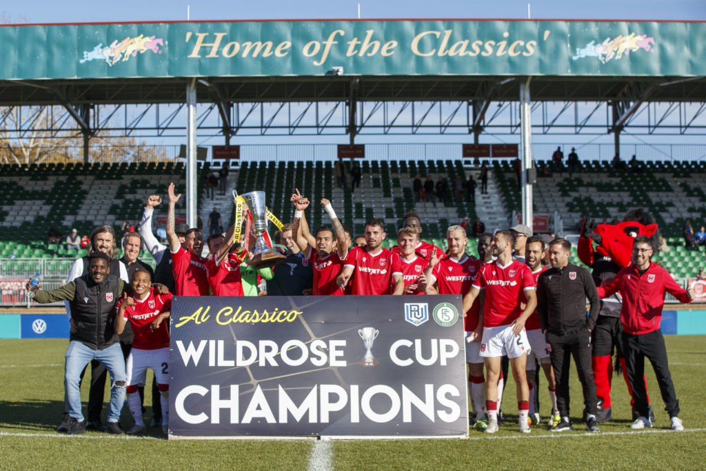 Cavalry FC celebrate winning the Wild Rose Cup after a match against FC Edmonton (CPL/Tony Lewis)