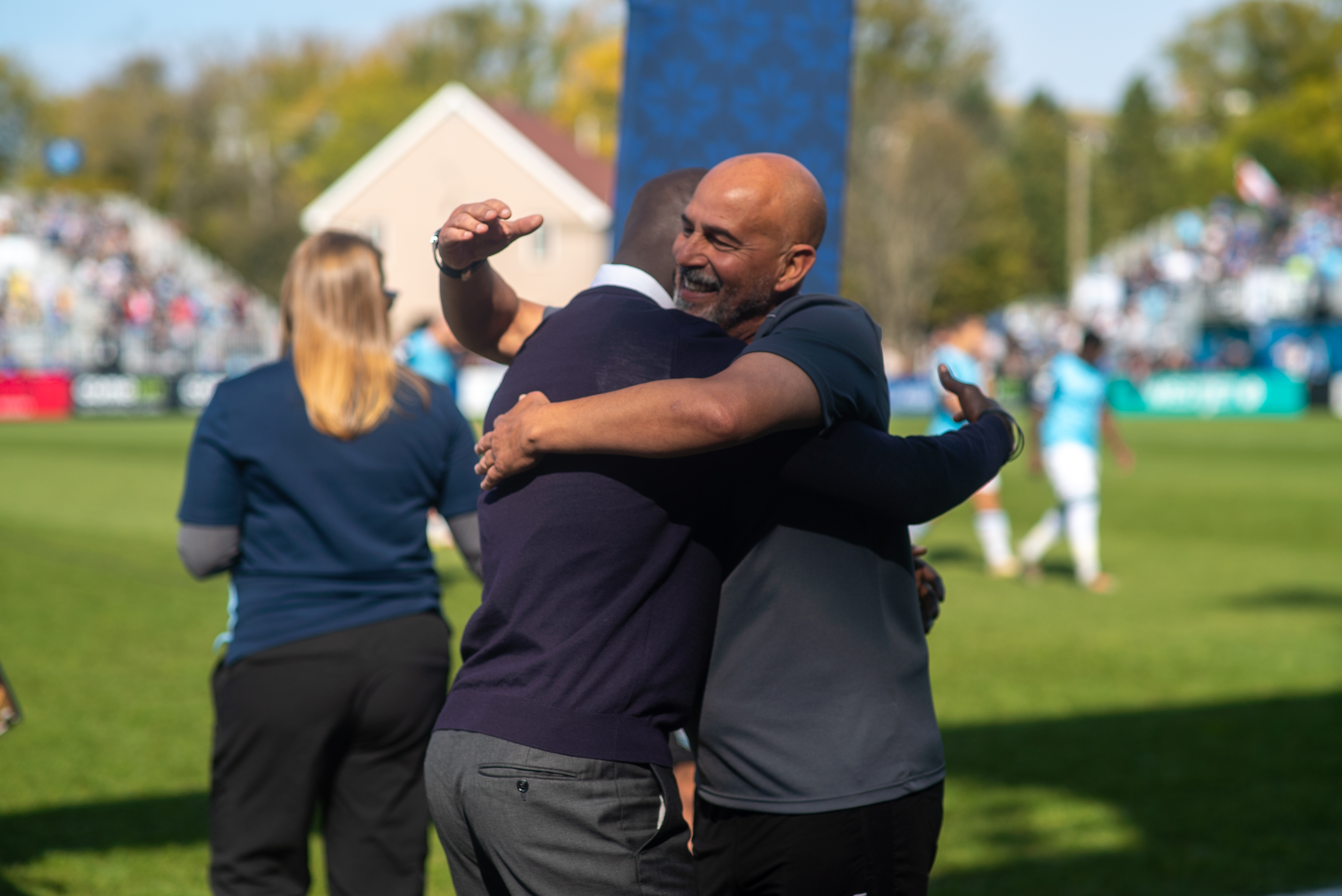 HFX Wanderers coach Stephen Hart embraces Pacific FC opposite Pa-Modou Kah. (Dylan Lawrence/HFX Wanderers)