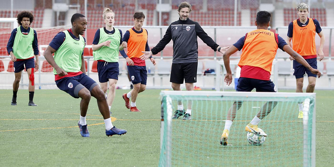 Atlético Ottawa coach Mista directing training during pre-season in Spain.