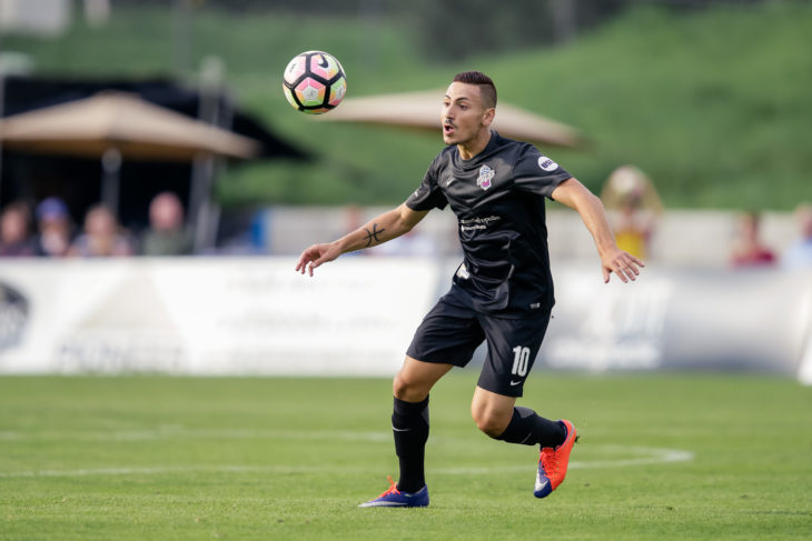 Aug 5, 2017; Colorado Springs, CO, USA; Colorado Springs Switchbacks FC midfielder Masta Kacher (10) fields the ball in the first half against Portland Timbers 2 at Weidner Field. Credit: Isaiah J. Downing/Switchbacks FC