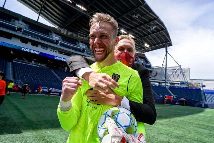 June 27, 2021. Forge FC vs. Valour. Second-Half. Head Coach Rob Gale celebrates with goalkeeper Jonathan Sirois